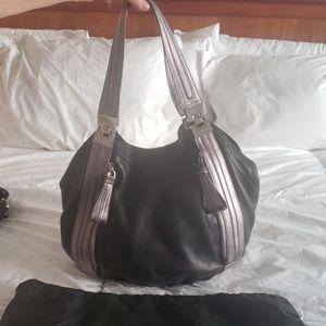 B. Makowsky leather bag. Leopard interior.